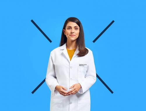 A Express Scripts pharmacist in a white lab coat